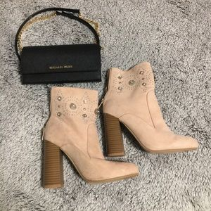 Pink suede heeled boots